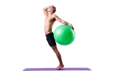 Man with swiss ball doing exercises on white Stock Photo - 19142365