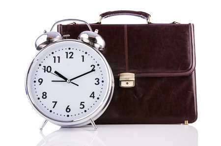 Alarm clock and briefcase isolated on white Stock Photo - 19329243