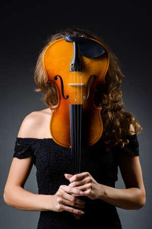 Attractive woman with cello in studio Stock Photo - 19323506