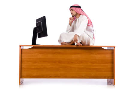 Arab man sitting at his desk photo
