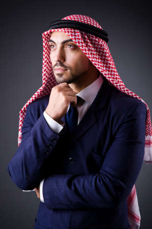 Arab businessman in dark studio Stock Photo - 19323796