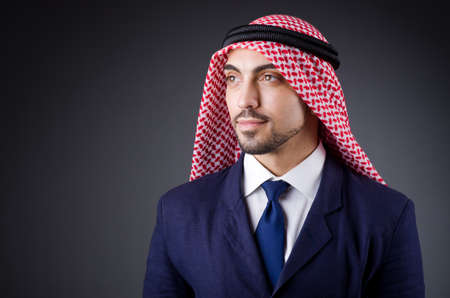 Arab businessman in dark studio Stock Photo - 19323754