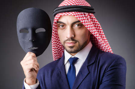 Arab with masks in dark studio Stock Photo - 19323789