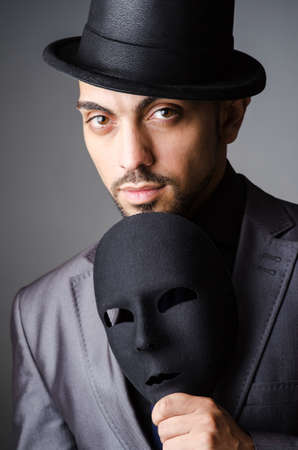 Man with mask in the dark Stock Photo - 19323784
