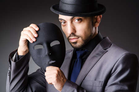 Man with mask in the dark Stock Photo - 19323791