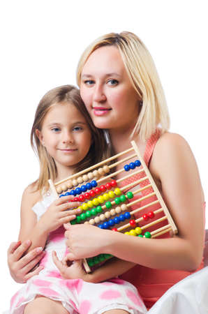Mother and daughter with abacus on white photo