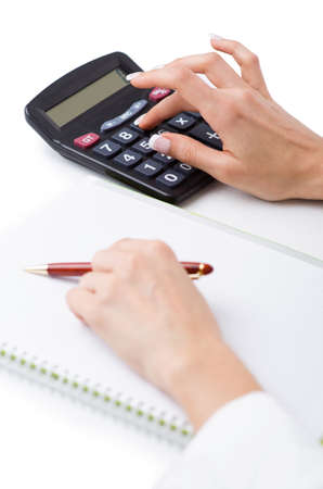 Hands working on the calculator Stock Photo - 19324889