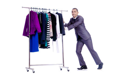 Businessman with rack of clothing photo