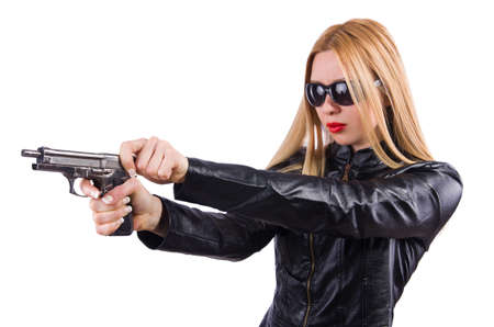 Woman in leather suit with handgun photo