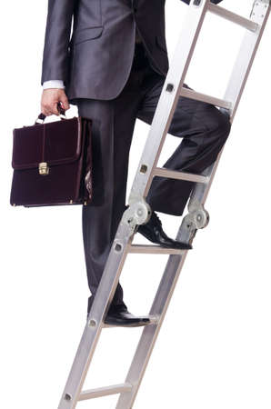 Businessman climbing the ladder isolated on white photo