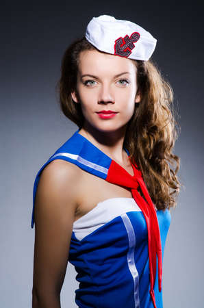 Young woman sailor in marine concept photo
