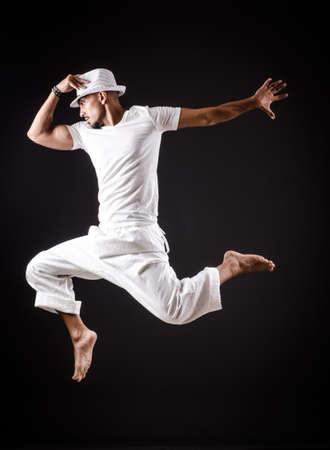male ballet dancer: Dancer dancing dances in white clothing Stock Photo