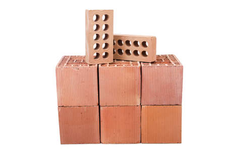 Stack of clay bricks isolated on white Stock Photo - 19325132
