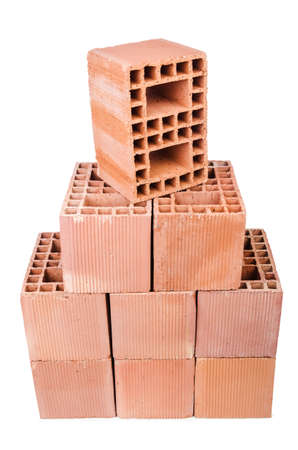 Stack of clay bricks isolated on white Stock Photo - 19329275