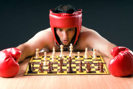 Boxer stuggling with chess game photo