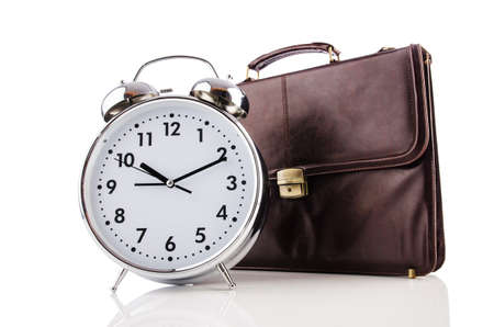 Alarm clock and briefcase isolated on white Stock Photo - 19373748