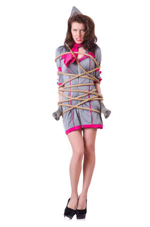 Female stewardess tied with rope Stock Photo