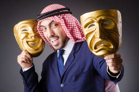 Arab with masks in dark studio Stock Photo - 19480637