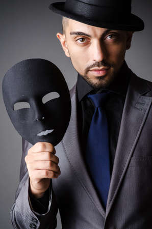 Man with mask in the dark Stock Photo - 19480471