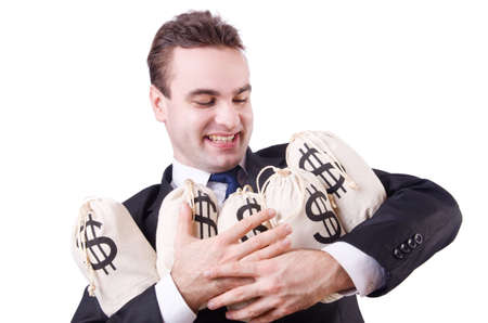 Businessman with sacks of money on white photo