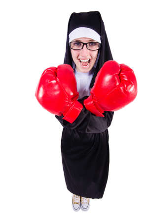 Nun with boxing gloves isolated on white photo