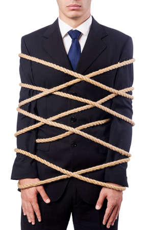 office slave: Businessman tied up with rope on white