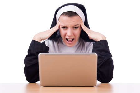 Nun working on laptop - religious concept Stock Photo - 19482510