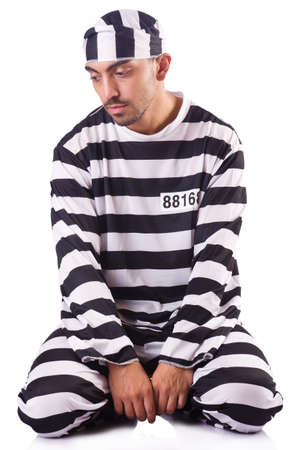 Inmate in stiped uniform on white photo