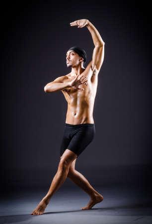 Dancer dancing in the dark studio Stock Photo - 19482546
