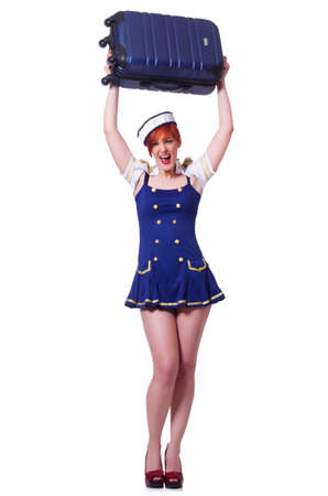 Airhostess with luggage on white photo