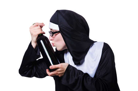 Nun with bottle of wine on white photo