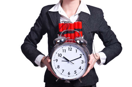 detonate: Woman with dynamite and clock on white Stock Photo