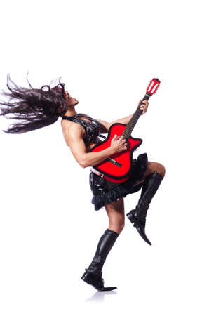 travesty: Man in woman clothing with guitar