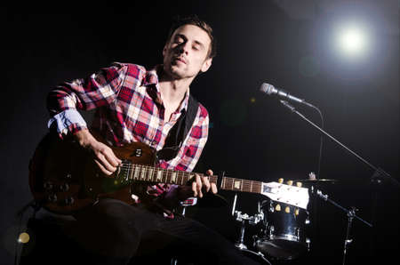 Man playing guitar during concert Stock Photo