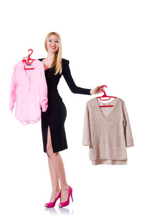 Woman trying to choose dress on white Stock Photo - 19433815