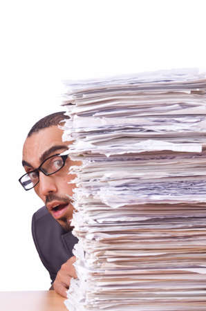 Busy businessman with lots of papers photo