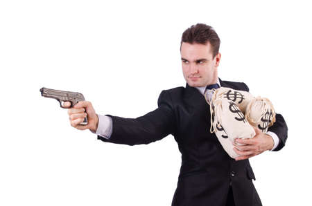 Man with gun and sacks of money photo