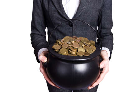 Woman holding pot of gold coins photo