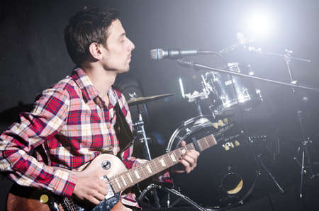 Man playing guitar during concert photo