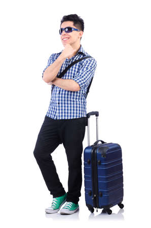 Young guy with travel case on white photo