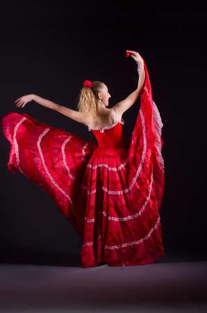 flamenco dress: Girl in red dress dancing dance Stock Photo