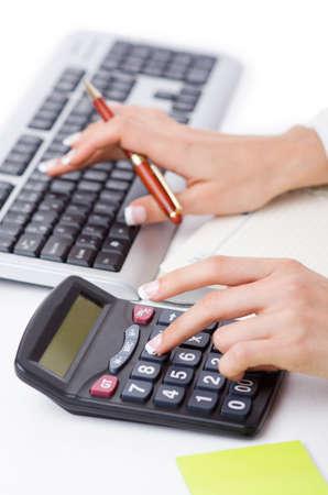 calculator money: Hands working on the calculator