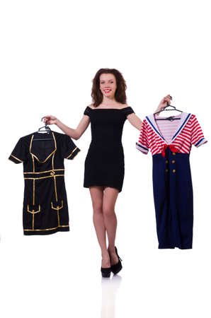 Woman trying to choose dress on white Stock Photo - 19642703