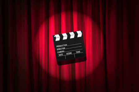 Movie clapper board against curtain Stock Photo - 19531489