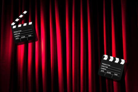 Movie clapper board against curtain Stock Photo - 19531504
