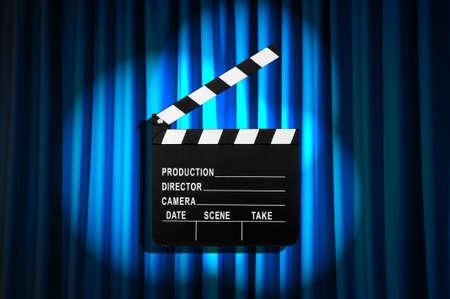 Movie clapper board against curtain Stock Photo - 19531506