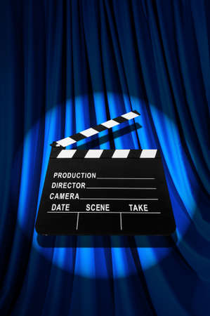Movie clapper board against curtain Stock Photo - 19531508