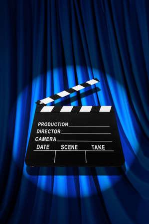 Movie clapper board against curtain Stock Photo - 19531508
