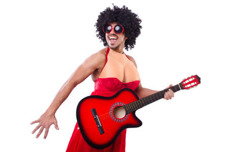Man in woman clothing with guitar photo