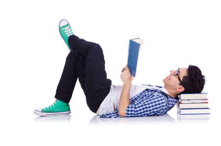 Estudiante con un montón de libros en blanco Foto de archivo